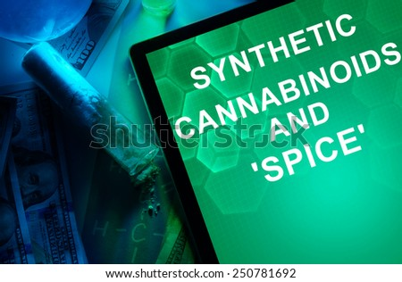 Tablet with words Synthetic cannabinoids and Spice. Drugs and Narcotics - stock photo