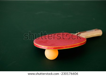 tabletennis racket and ball on table - stock photo