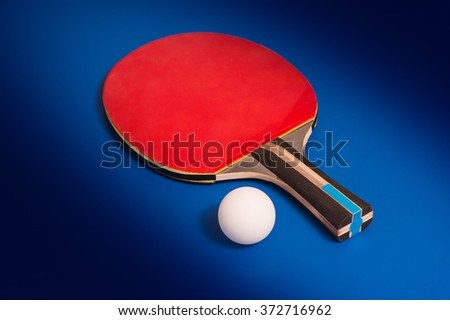 Tabletennis racket and ball on table