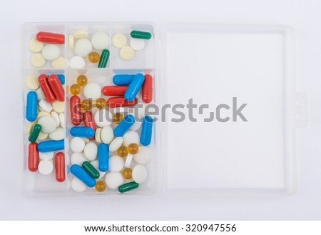 Tablets and capsules for medicines glass box. - stock photo