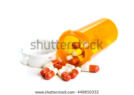 Tablets and capsules in the dispenser - stock photo
