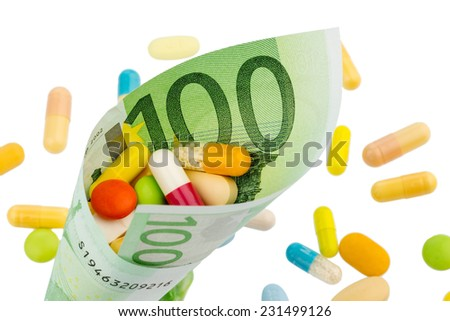 tablets and one hundred euro banknote symbolic photo costs for medicine and drugs the pharmaceutical industry - stock photo