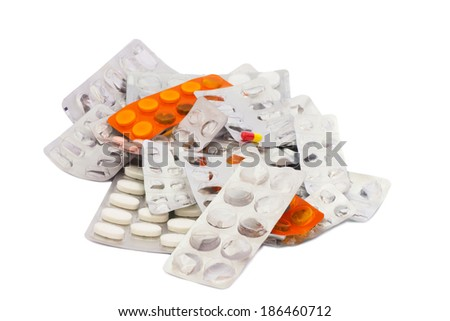 Tablets and Pills in Blister and Many Empty Pill Blister Packages. Isolated on a White Background. - stock photo