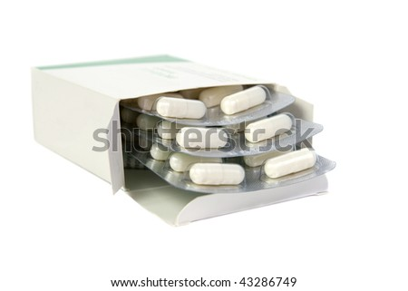 Tablets in a package. Isolated on white background. - stock photo