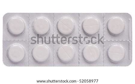 Tablets in push-through strip on white - stock photo