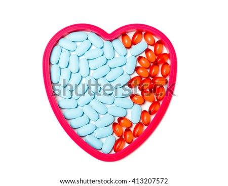 tablets in the form of heart isolated on white - stock photo