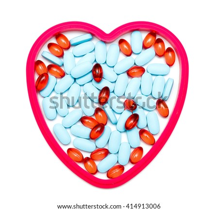 tablets in the form of heart isolated on white