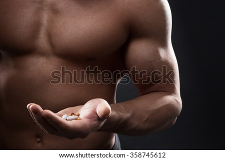 Tablets in the hand of an athlete