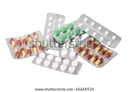 Tablets on white background - stock photo