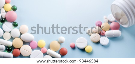 Tablets with capsules. With a place for the text - stock photo