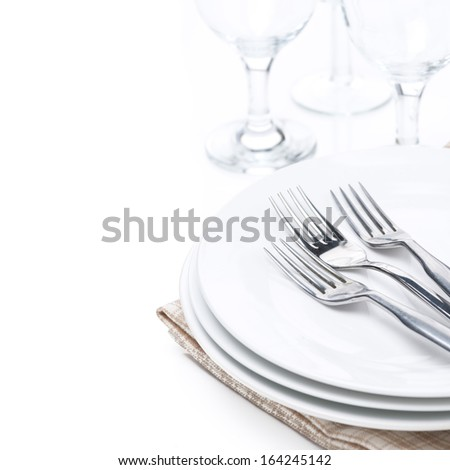 tableware - plates, forks and glasses, isolated on white