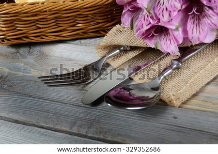 Tableware with flowers on wooden background close up - stock photo