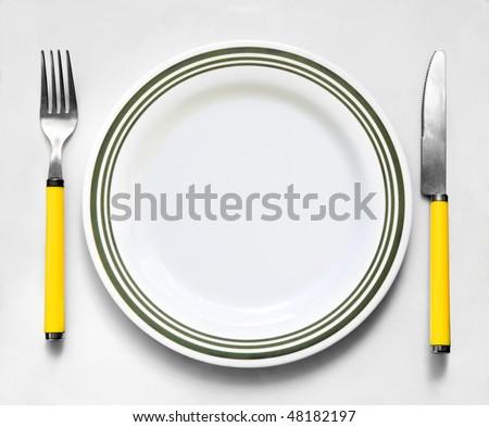 Tablewares on a white cloth - stock photo