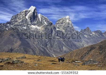 Taboche Mountain (6501m) and Trekking Path - As seen from Ama Dablam Base Camp, Himalayas, Nepal - stock photo