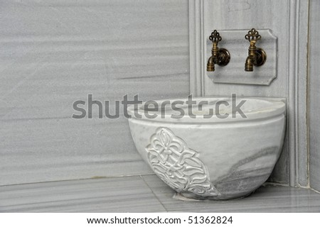 tabs and a marble basin in a turkish bath - stock photo