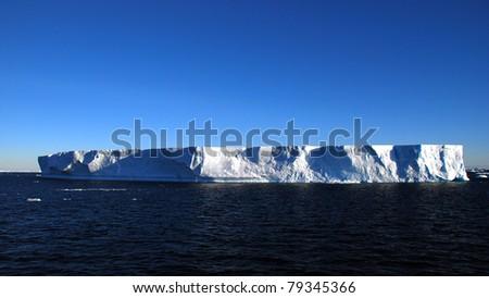 tabular iceberg in open sea, antarctica - stock photo