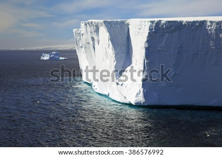 Tabular iceberg in the ocean near the Antarctic Peninsula (outside Hope Bay, Antarctica) - stock photo