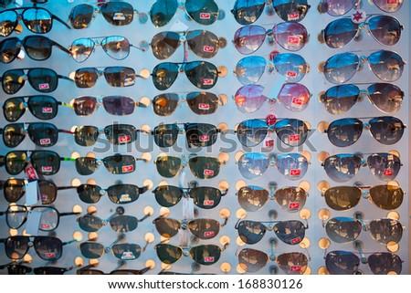 TACHILEIK - AUGUST 3, 2013 : Counterfeit goods of RayBan sunglasses in black market  in Tachileik, Burma. - stock photo