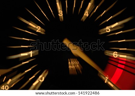 Tachometer at night - stock photo
