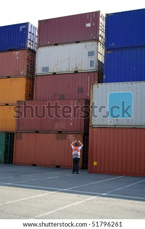 tacks of shipping containers at a port - stock photo