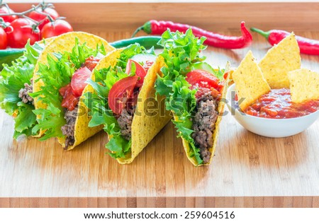 Taco, lettuce and fresh tomatoes - stock photo