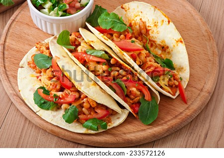Tacos with chicken and bell peppers - stock photo