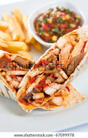 Tacos with french fries and sauce - stock photo