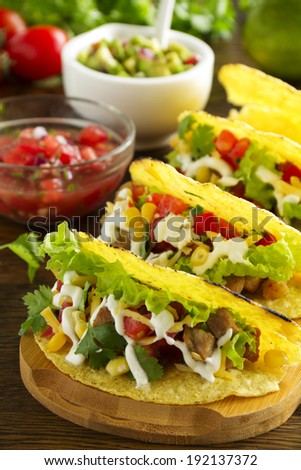 Tacos with pork and tomato salsa.