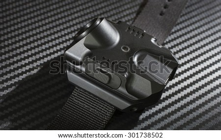Tactical flashlight that is worn on an operators arm - stock photo