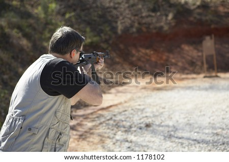Tactical police training on the shooting range - stock photo