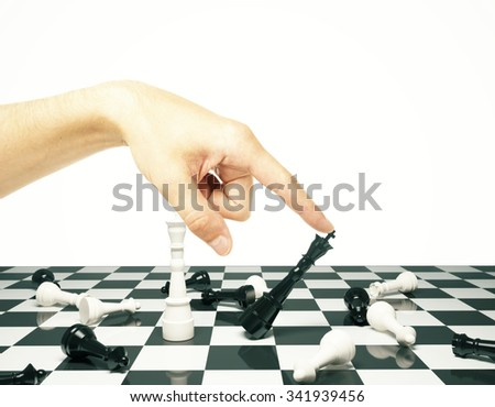 Tactics concept with chess pawns and human hand - stock photo