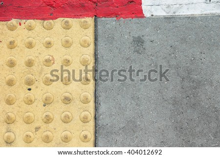 Tactile paving for blind handicap on the road - stock photo