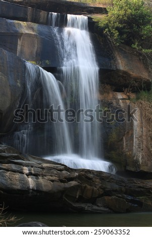 Tad Huang Waterfall the most big of Phu Suan Sai, become the murder line between Thai-Laos. , Waterfall in rain forest , water fall in deep forest at at Phu Suan Sai National Park, Loei Province - stock photo