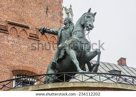 Tadeusz Kosciuszko monument near the castle entrance. Wawel castle in Krakow. Poland. - stock photo