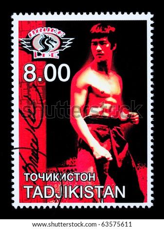 TADJIKISTAN - CIRCA 2000: A postage stamp printed in Tadjikistan showing Bruce Lee, circa 2000 - stock photo