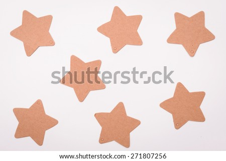 Tag in form of star on white background  - stock photo