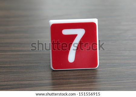 Tag number seven on a table