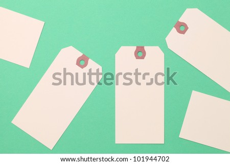 Tag or label on green paper background - stock photo