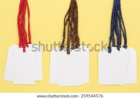 Tag or label on yellow paper background  - stock photo