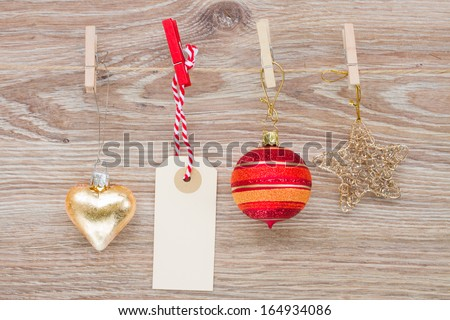 tag with christmas decorations hanging on rope - stock photo