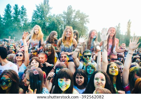 TAGANROG, RUSSIAN FEDERATION - June 01, 2015.  India colour Holi Festival. Crowd of  smeared colourful happy people raising hands.