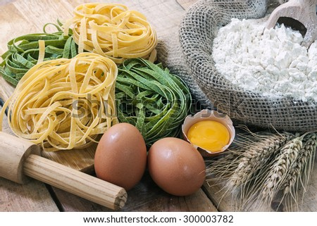 tagliatelle and ingredients with background - stock photo