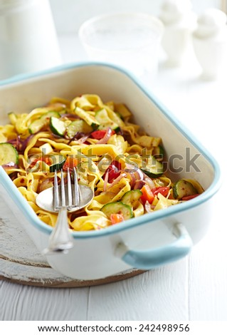 Tagliatelle baked with vegetables and parmesan - stock photo