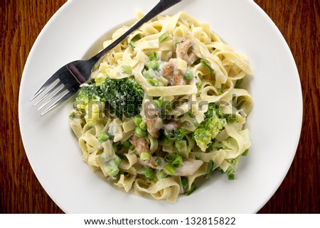 tagliatelle pasta with chicken and vegetables - stock photo