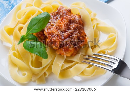 Tagliatelle pasta with meat bolognese sauce and cheese. Italian cuisine.