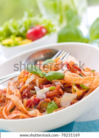 Tagliatelle pasta with tomato and vegetable sauce