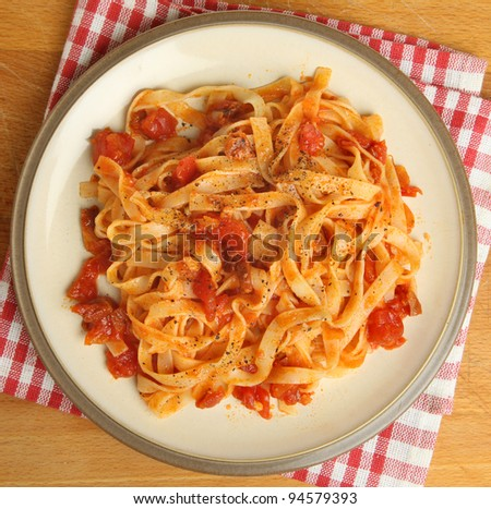 Tagliatelle pasta with tomato sauce and freshly ground pepper - stock photo
