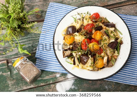 Tagliatelle pasta with vegetables in a rustic plate