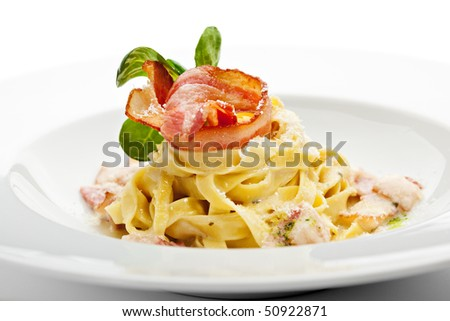 Tagliatelle with Carbonara Sauce, Bacon and Yolk of Quail Egg - stock photo