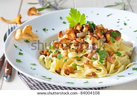 Tagliatelle with fried fresh chanterelles - stock photo